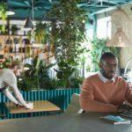 Businessman in Green Cafe Interior
